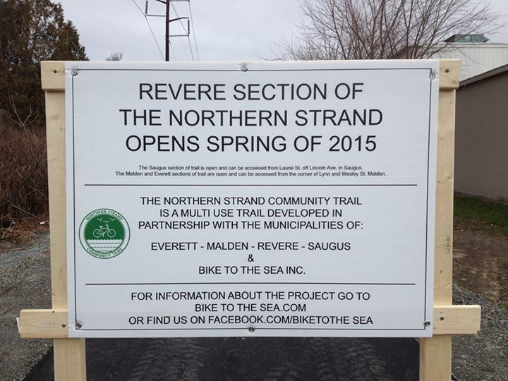 Sign announcing Revere portion of trail to open in spring 2015