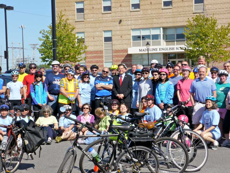 Bicyclists pose for a photo before the start of the Bike to the Sea Day Ride.