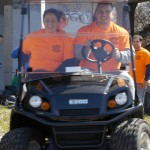 Volunteers from Revere Shines ride in a golf cart at the cleanup.