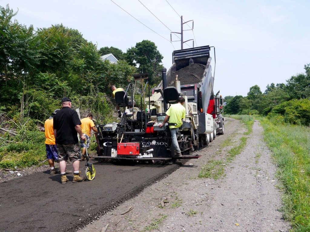 A paving crew on the trail in Revere.