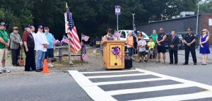 Flags and people flanked a podium on the Saugus portion of the trail.