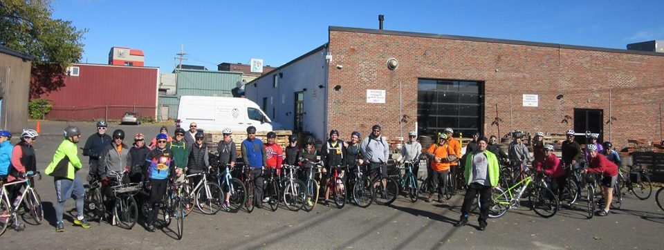 Bicyclists in front of Night Shift Brewing in Everett.