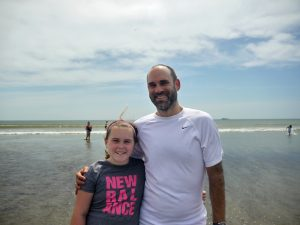 A father and daughter pose for a photo at the end of the ride at Nahant Beach.