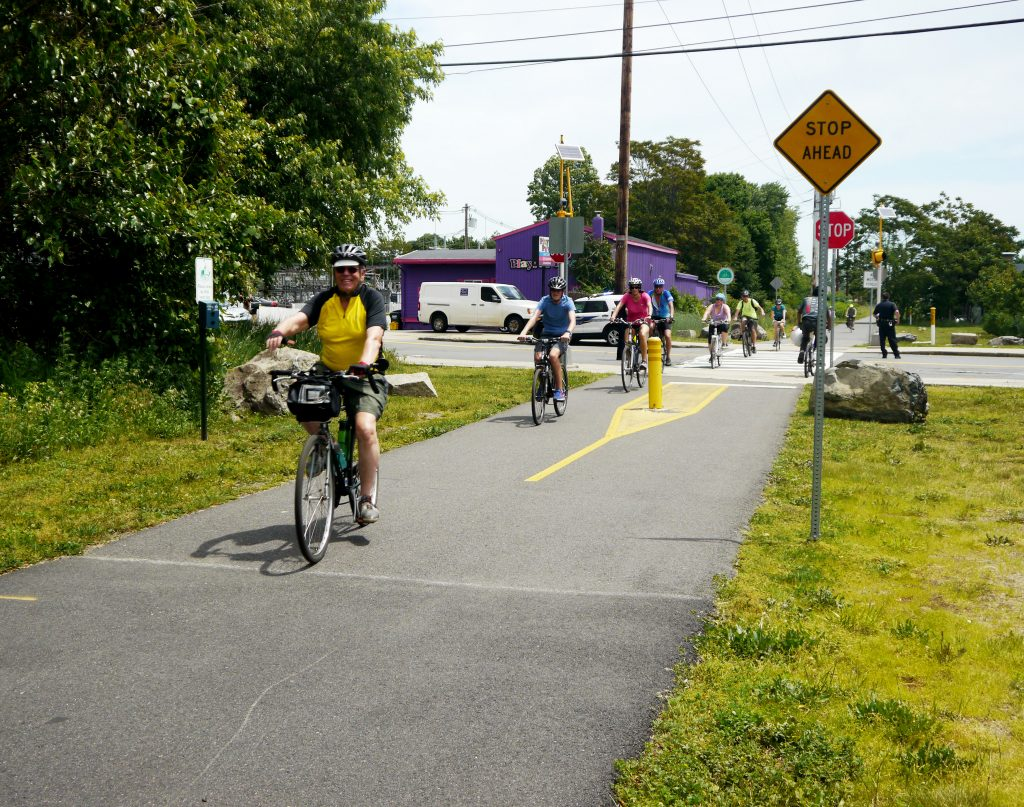 Cyclists riding on the trail.