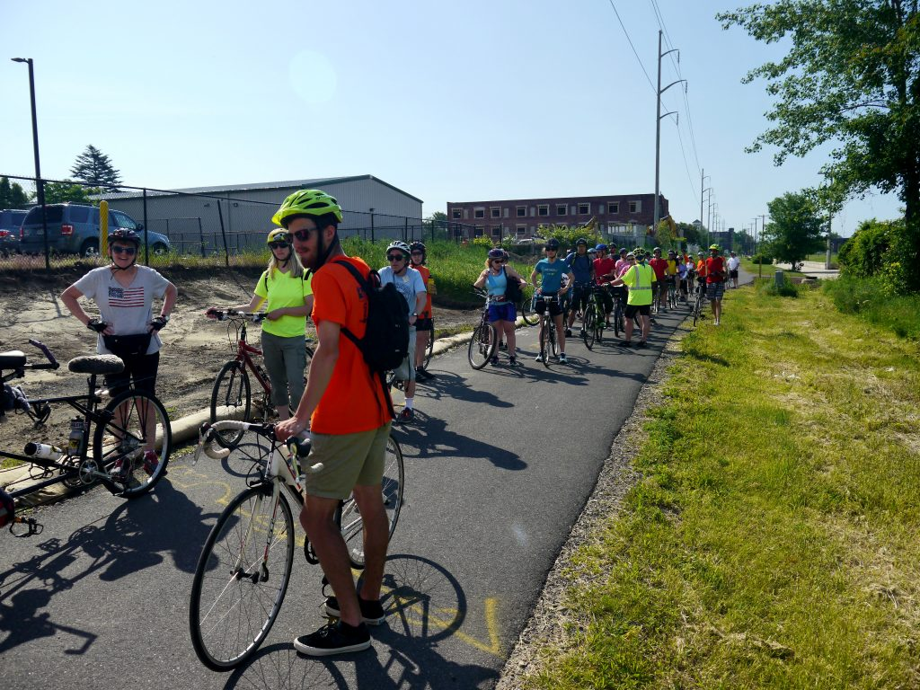 Cyclists line up along the trail.