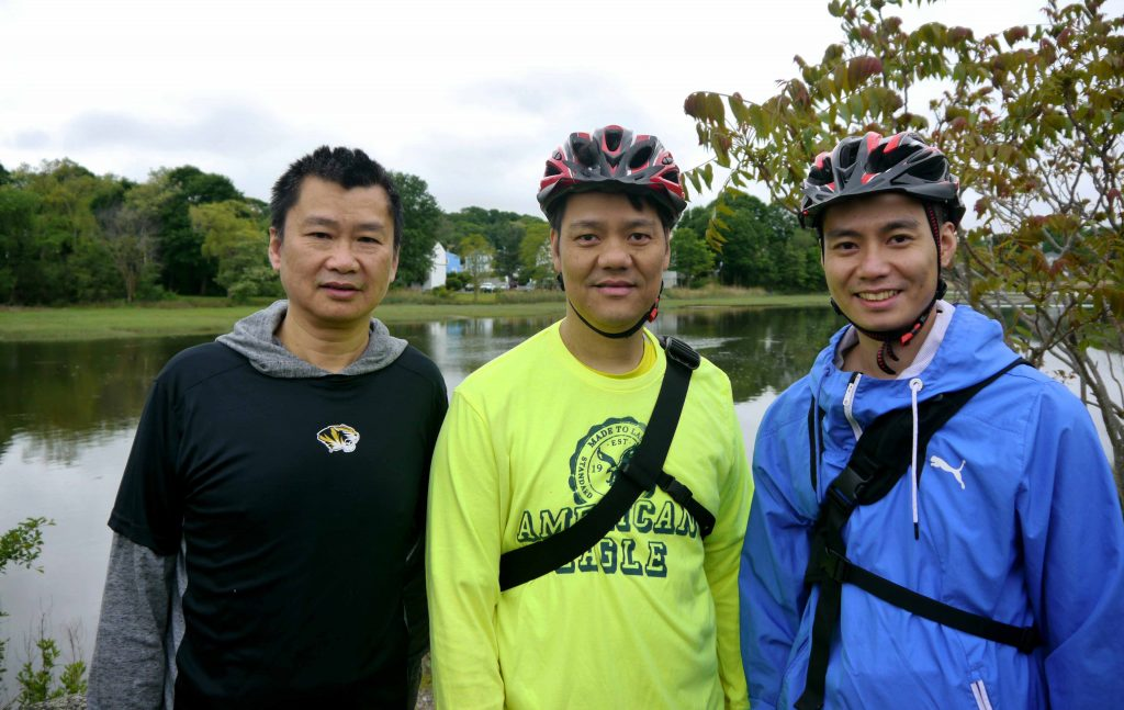 Cyclists pose for a photo.