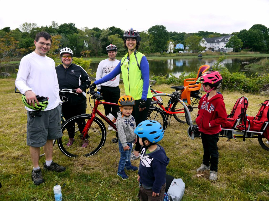 Parents and children take a break with their bikes.