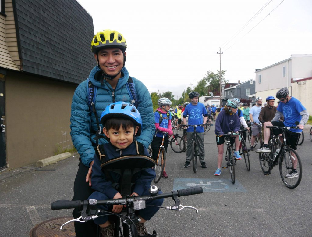 Father and young son on a bike.