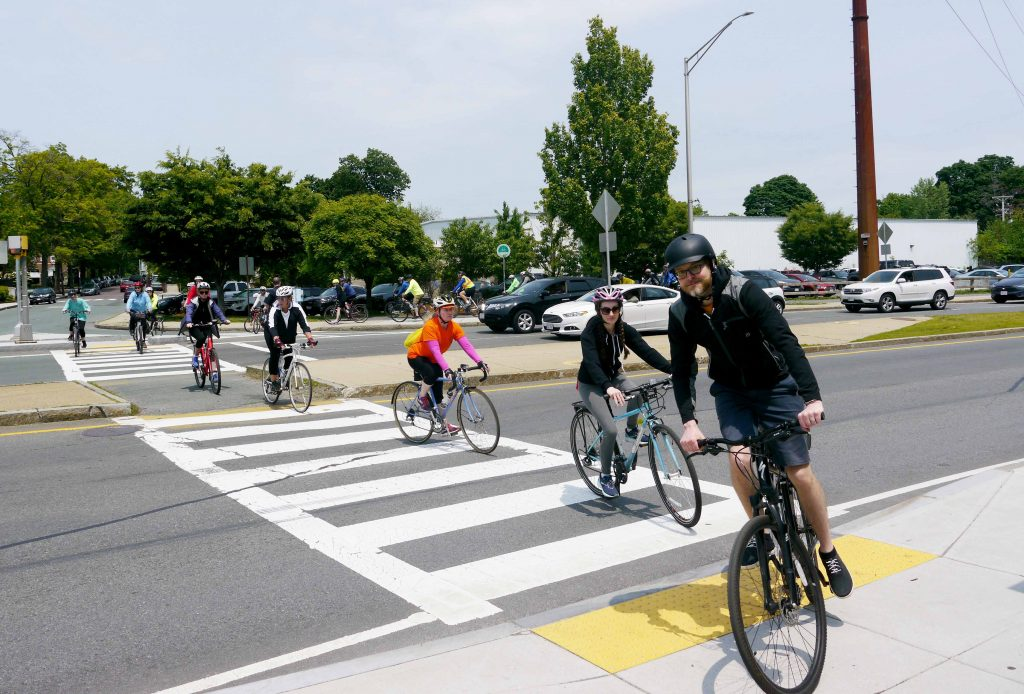 Bicylclist cross the street.