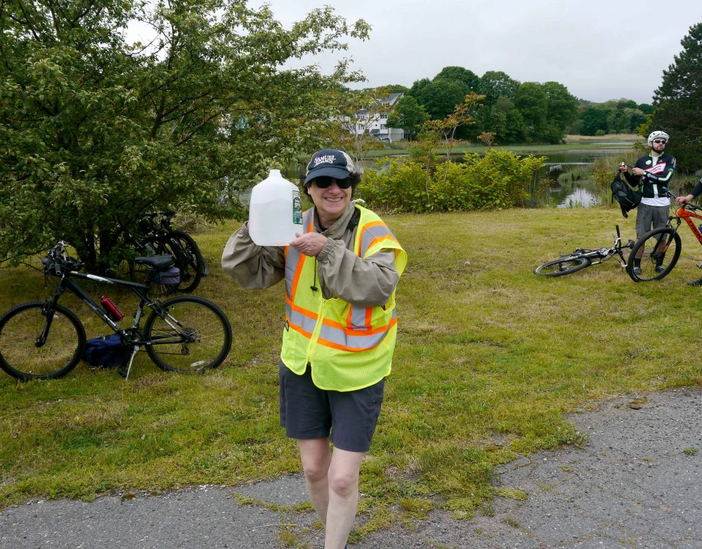 Bike to the Sea President Janet Green holds up a jug of water.